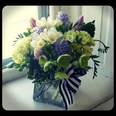 Soft combination of green, lavender and cream set off with a graphic ribbon. Roberts Flowers of Hanover, Hanover, NH