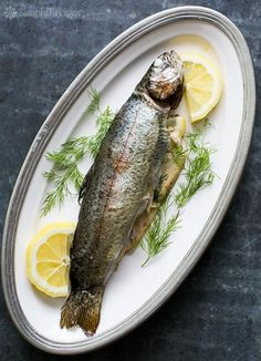 Grilled Trout with Dill and Lemon ~ How to grill whole trout, stuffed with lemon, dill, and dotted with butter. Easy! ~ SimplyRecipes.com