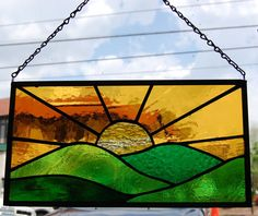Stained glass sunrise over mountain hills