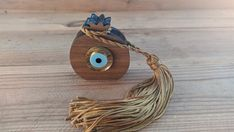Good luck tassel ornament, house protection, new years 2020 evil eye gift Necklace Sizes, Bracelet Sizes, Baby Jewelry, Handmade Jewelry, Plexiglass, Home Protection, Grenade, Evil Eye Jewelry, Wooden Ornaments