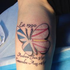 Butterfly tattoo with the Newfoundland flag inside