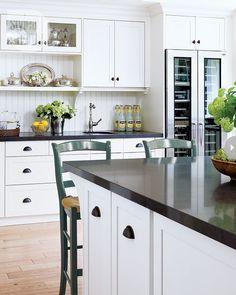 Two Classic White Kitchens To Copy   Maria Killam Absolute black countertops, true-white cabinets and rift white oak hardwood floors.