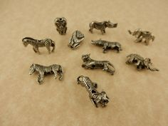 10 antique pewter assorted wild animal beads, rhino, tiger, elephant, lion…
