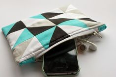 I've seen a number of gorgeous quilts with a similar design using half square triangles around, particularly on pinterest. I wanted to give it a try but on a smaller scale, so I made this little zip pouch. I love the geometric look and the use of solids, which I don't use very often but…