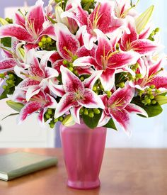 Stargazer lilies - I think this is my all time favorite flower. I had planted them in the front garden below the living room window. The smell of them when you left the windows open and their beautiful colors just makes them my favorite.