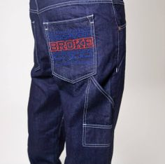 Denim 13oz rinse washed. Large embroidery on right back pocket. Baggy fit. Available on www.brokeclothing.com