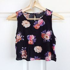✨HP✨ Floral Crop Top Black floral crop top from ShopRuche. Never worn, perfect for summer! Size medium but fits more like XS/S. Listing is only for crop top, other items are only being used for display. Host Pick | Spring Fling Party | 03-07-16 ShopRuche Tops Crop Tops