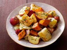 Sandra's Mixed Roasted Potatoes with Herb Butter : Sandra Lee combines russet, red-skinned and sweet potatoes for a crisp, colorful potato side dish. Her herb-infused butter takes the flavor up another notch.