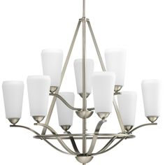 Moments Collection: An urban-inspired family. Elongated profile on etched white glass. This nine-light chandelier is $1,254.00