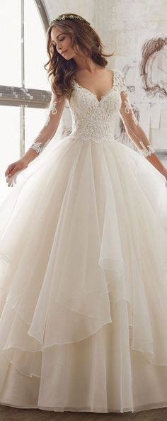 v neck ball gown from Morilee with lace sleeves #wedding #weddingdresses