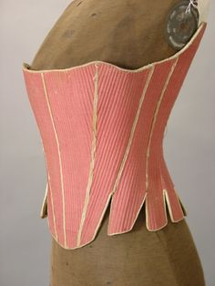 Wool and linen stays dating to 1760-80, likely American.  An extremely rare rose color wool lined in blue and buff checked inner lining, with kid leather edging.  Sold on e-Bay in October 2004 for 2,324.52