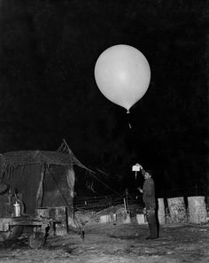 Releasing a Radiosonde, 1952 Member of the Field Artillery Meteorological and Topographical Detachment, U. Army prepares to release a radiosonde into the night in December Weather Balloon, See The Sun, Meteorology, Korean War, Cold War, World History, Military History, Fields, Army