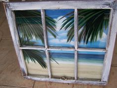 Awesome upcycled window with beach scene and reverse painted palm leaves.  Had to keep this one.