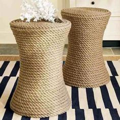 Cute and functional, these end tables are a great way to add rope to your decor, and they're easier to make than they look! Take an older end table, or perhaps a cheaper plastic model, and —you guessed it — cover with adhesive before wrapping with rope!