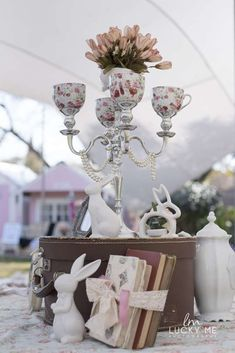 How cute is this vintage candle stick with tea cups? What a gorgeous party decorations!! See more party ideas and share yours at CatchMyparty.com  #catchmyparty #partyideas #bunnyparty #easter #partydecor #centerpiece #partydecoration #shabbychic #teaparty #girlbirthdayparty