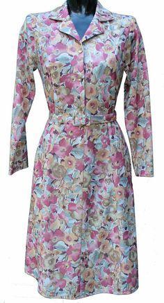 Long sleeve dress by Rival .Pink/Burnt orange Flower pattern