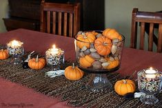 Easy Fall Popcorn Votive Candles. Nice Thanksgiving / Fall table centerpiece using popcorn and pumpkins.
