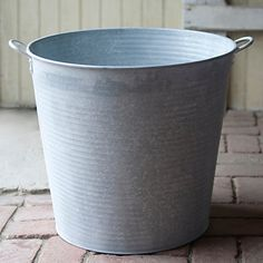 Made from bright, lightweight zinc, these tall pails add eye-catching shine to planted perennials, or serve as practical totes around the home and gar Garden Coffee Table, Coffee Table Books, Garden Gifts, Planters, Deck, Cottage, Holiday, Kitchen, Products