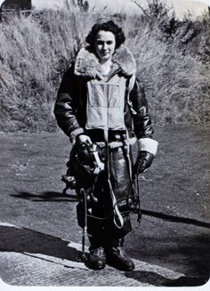 Mary, pilot in the Air Transport Auxiliary, in gear to fly her Spitfire, c. 1944 during WWII