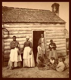 "SLAVES, EX-SLAVES, and CHILDREN OF SLAVES IN THE AMERICAN SOUTH, 1860 -1900 (2) -- And one WHITE KID with Back to the Camera    ""Aunt Betsey's Cabin"" in South Carolina."