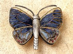 Polymer clay micromosaic butterfly by Cynthia Toops; metalwork by Chuck Domitrovich.