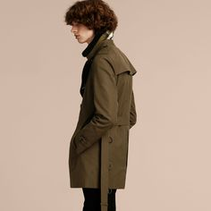 A cotton gabardine Burberry trench coat with a detachable shearling topcollar and check warmer to adjust to changing temperatures.