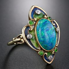 Ring |  Designer ?.  Art Nouveau.  Opal, Diamond & Demantoid Garnet with  Enamel set in gold