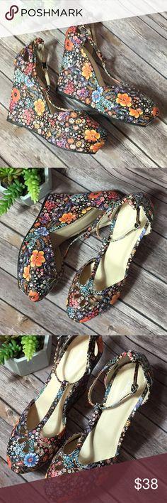 Dark floral wedges never worn nwob sz 9 Dark floral wedges never worn nwob sz 9. So cute. True to size. BAMBOO Shoes Wedges