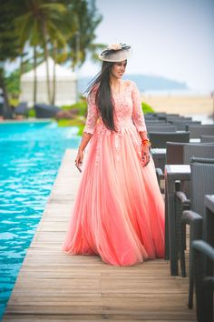 Peach tulle gown for a fun filled pre wedding function by the pool side.