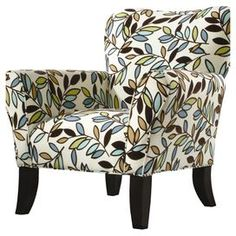 Contemporary arm chair with floral upholstery and a sculpted back. Made in the USA.   Product: ChairConstruction Material: Wood and fabricColor: White, green and blueFeatures:  Floral printContemporary style Dimensions: 38 H x 37 W x 38 D