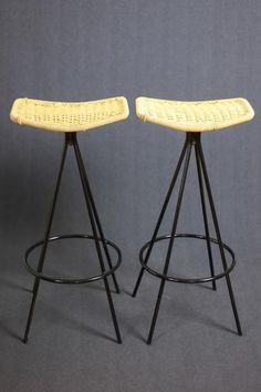 Two Mid Century Cane and Steel Bar Chairs