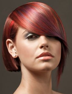 Asymmetrical short hairstyle, modern look, cute highlights (blue, orange on red short hair)