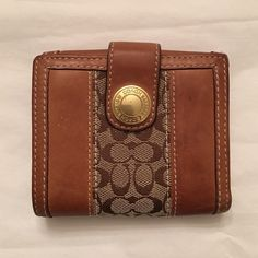 Coach Bifold Wallet Authentic coach tan leather wallet. This was my favorite and it got used alot. it has sign of wear but no rips or fraying on the leather edges. This wallet have lots of CC pockets, ID window , 2 currency side pockets and a coin pocket as well. Gold hardware Coach Bags Wallets