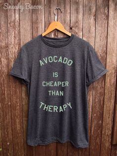 Welcome to the Sneaky Bacon Clothing Shop!   About this product  This Avocado is cheaper than Therapy green print Tshirt is made of premium