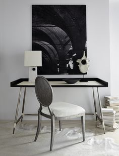 Gorgeous minimalist desk from Bernhardt Furniture has simplistically beautiful tapered legs and leather strap details.
