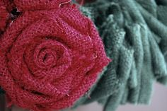 tutorial on making burlap roses - easy peasy!  Going to make these into magnets for my new kitchen desk message board and for B's room and her message board...or maybe attach to clothes pins for the chicken wire message board above her soon to be desk!