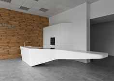 Lithuanian design studio Rimartus looked to the shapes of flying birds to design its minimal Wing kitchen for manufacturer Imprimere.