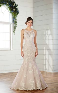 Essense of Australia #D2534 - The high, illusion-lace neckline of this Essense of Australia gown sets the stage, while balancing out the sweetheart neckline perfectly. The high neckline of this gown extends through to the open V-back.