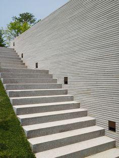 Timber wall, terrazo floor
