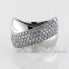 89 = – SI round brilliant cut diamonds set on one of the bands of a criss-cross ring design in white gold Crossover Ring, Dress Rings, Ring Designs, Criss Cross, Bands, Diamonds, White Gold, Sparkle, Classy