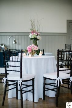 White wedding | Floral centerpiece | Designed by Engaging Events