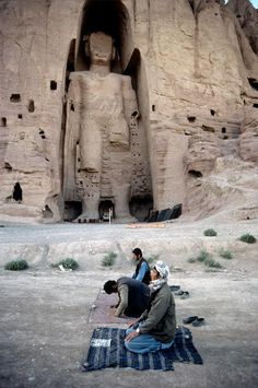 Men in Prayer - Afghanistan - is this the buddha that got blow up?