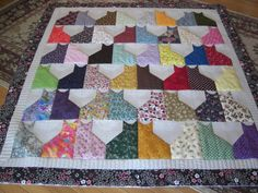 Scrappy Cats Quilt posted by DeeBooper from the quiltingboard.com - I think this is how I will quilt my kitty table runner.