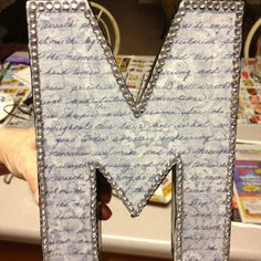 Cardboard letter from Joann's, scrapbook paper, paint, Mod Podge and rhinestones. I love how this turned out!
