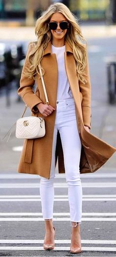 #spring #outfits selective focus photography of woman in brown long coat standing on pedestrian. Pic by @manhattan_fashion_styles