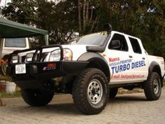 Almost exactly how I'd do it, except different wheels and no decals Nissan 4x4, Nissan Navara, Nissan Frontier 4x4, Nissan Terrano, Nissan Patrol, Toyota Trucks, Ford Ranger, Cars Motorcycles, Ideas Para