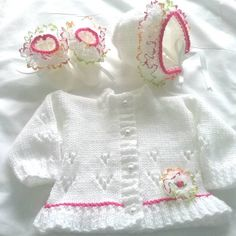Brand new design for spring hand knitted in baby acrylic double knit this one is to fit newborn Knitted Baby Outfits, Knitted Baby Cardigan, Baby Pullover, Knitted Baby Clothes, Knitting Stiches, Baby Knitting Patterns, Hand Knitting, Knitting For Kids, Double Knitting