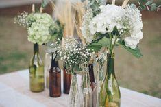 mixed glass bottles - photo by Sarah Beth Photography http://ruffledblog.com/intimate-louisiana-wedding