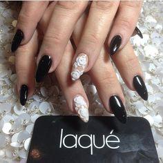 Black Stiletto Nails with 3D Flower Design by laqué nail bar @laquenailbar Instagram