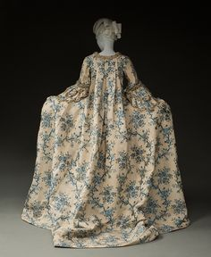 Rear view, robe à la francaise, fabric: France (Lyon or Tours) or probably China for the export market, 1765-1770. Cream silk brocaded with blue floral motifs, linen lining, golden lace trim.